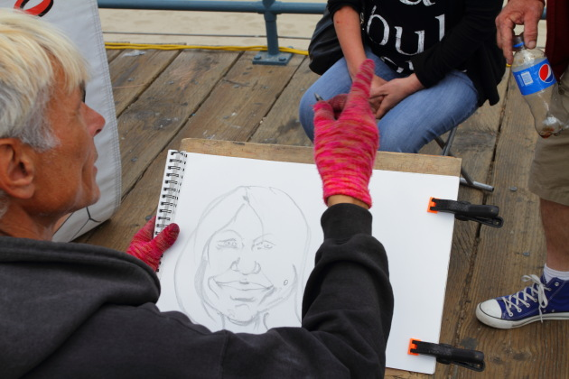 Caricature artists at work at Santa Monica Pier