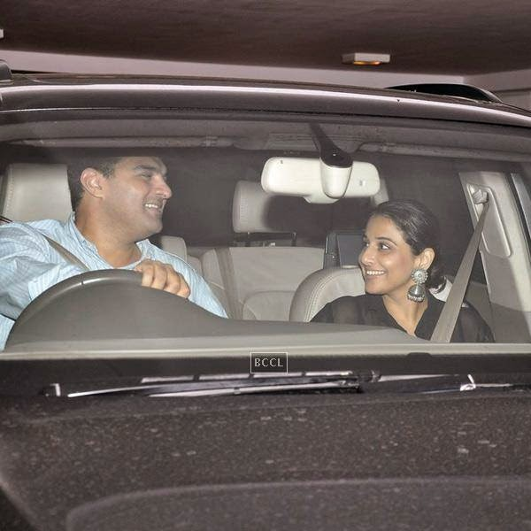 Siddharth Roy Kapur and Vidya Balan leave after attending Karan Johar's party, organised at his residence, on July 26, 2014.(Pic: Viral Bhayani)