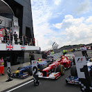 Mark Webber jumps the podium in England