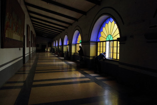 Corridor of colourful windows in St. Augustine's Church, Manila, Philippines