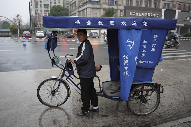 man with his cycle-ricksha in Shaoxing, China