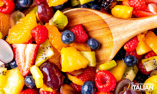 summer fruit salad recipe with a spoon