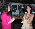 Cassie McQuitty, United Way of Tarrant County staff member, greets Tara Trimmer from Burlington Northern Santa Fe.