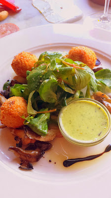Higgins Restaurant- dinner special appetizer of risotto balls with truffle and hedgehog mushrooms that came with fresh greens that only needed the barest whisper of dressing