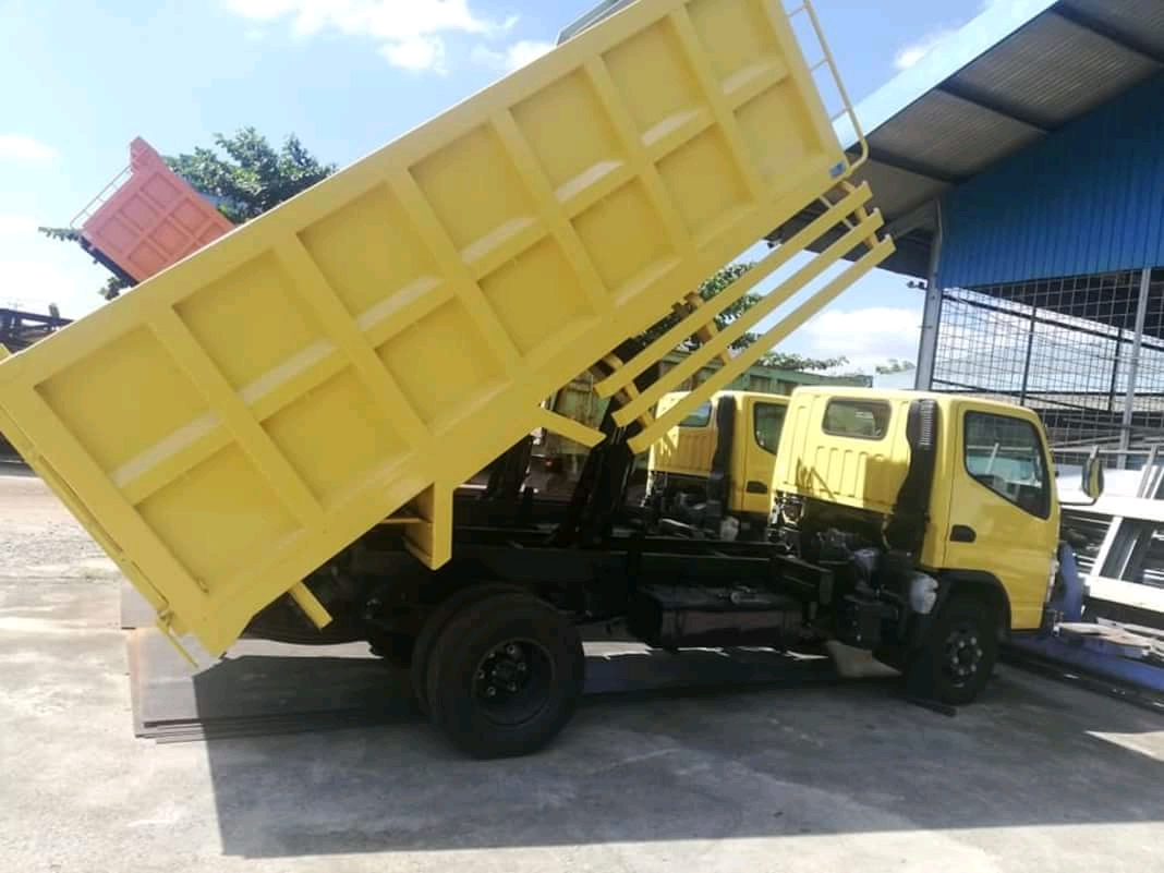 Harga dump truck baru pekanbaru
