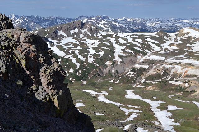 hills far below
