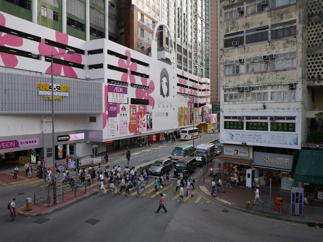 people crossing a road in Tsuen Wan, Hong Kong