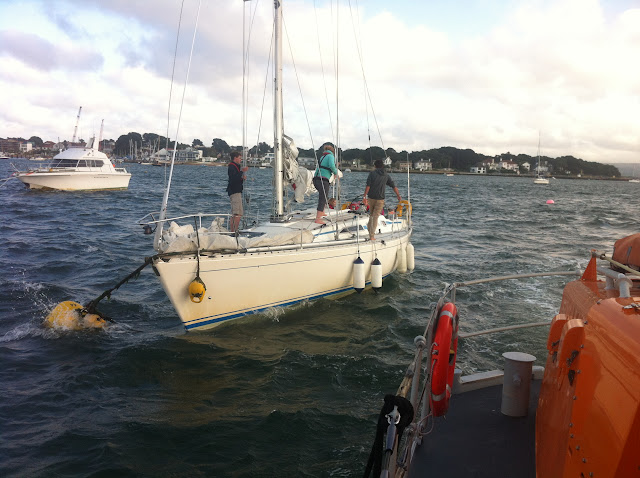 21 August 2012 - the yacht on anchor following the incident. Photo: RNLI Poole/Dave Riley