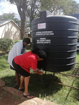 Sabina Chege distributing water tanks the whole county bus stages and markets
