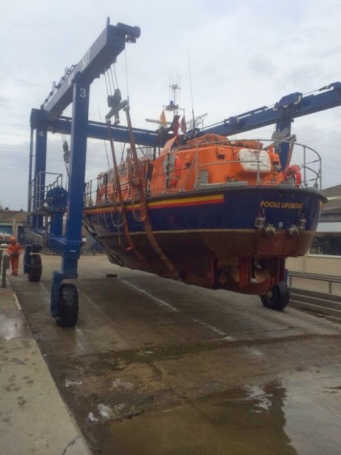 Poole's Tyne class lifeboat being lifted out of the water for a routine 'bottom' scrub. 31 March 2014 Photo: Paul Taylor