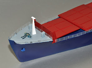 Photo: Bow of the 500-foot 2nd Gen container ship. Like other top decks, very clean. The booby hatches show that all the top decks were accessible from the interior by this time, eliminating outside ladders and stairways. The very tall breakwater just aft of the forecastle deck was built to protect the first layers of the front row of containers from the sea.