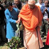 Swami Swahanandaji waters the newly planted tree