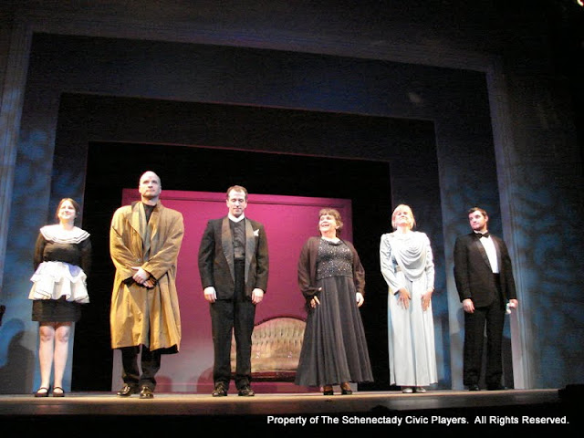 "Jennifer Van Iderstyne, Marty O'Connor, Tim Orcutt, Susan Katz, Cristine M. Loffredo and Paul Dederick in ""Mystery at Twicknam Vicarage"" as part of THE IVES HAVE IT - January/February 2012.  Property of The Schenectady Civic Players Theater Archive."