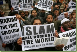 37379-muslims-carrying-banners-declaring-islam-will-dominate-the-world-protest-at-the-visit-of-mr-wilders-to-the-uk