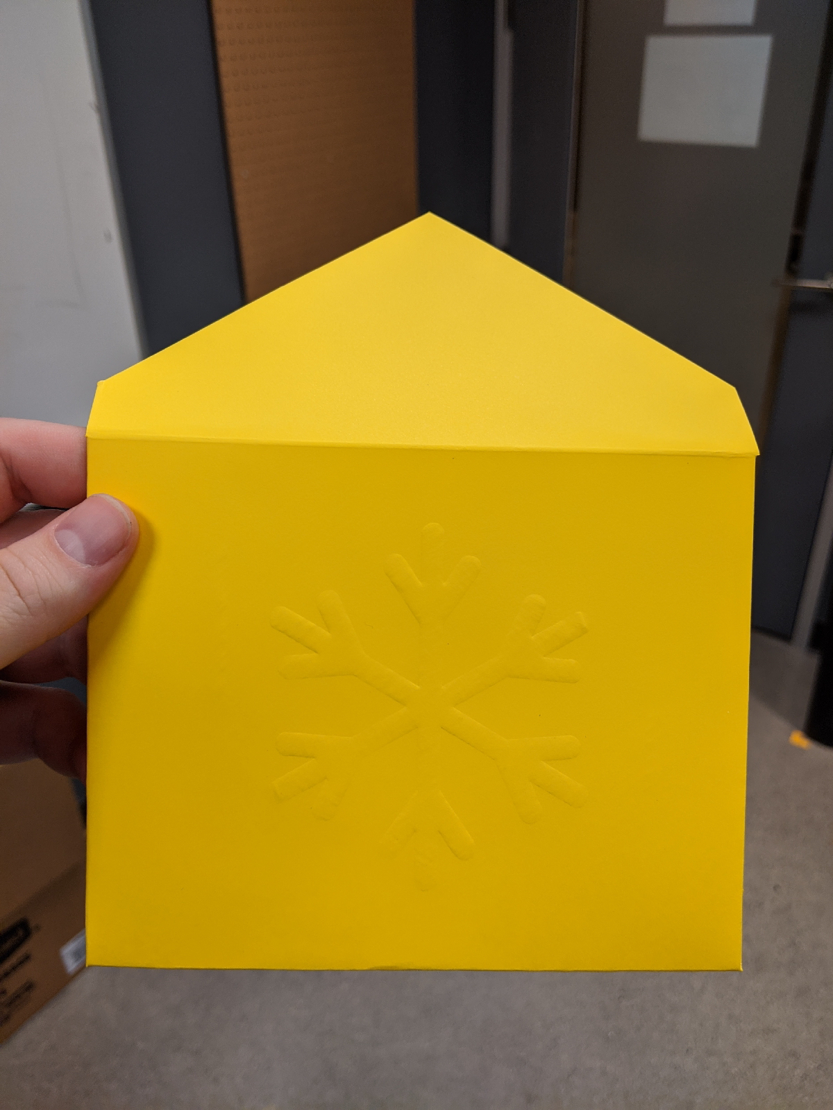 Photo of the back of the envelope, with an embossed snowflake