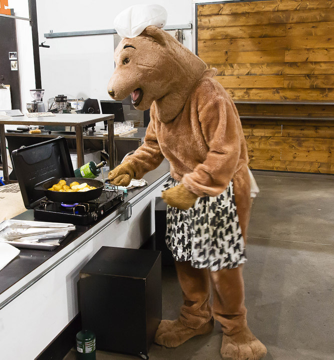 photo of bear cooking at the Cow By Bear dining event