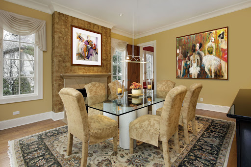 Piety and Intermediate - paintings by Julieta Valdez in a traditionally styled dining room