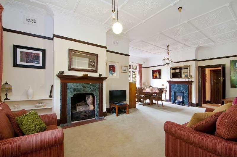 A delightful Federation Lounge room with original fireplaces and ceilings. Wonderful!