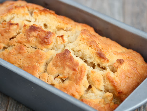 close-up photo of apple cider bread in a loaf pan