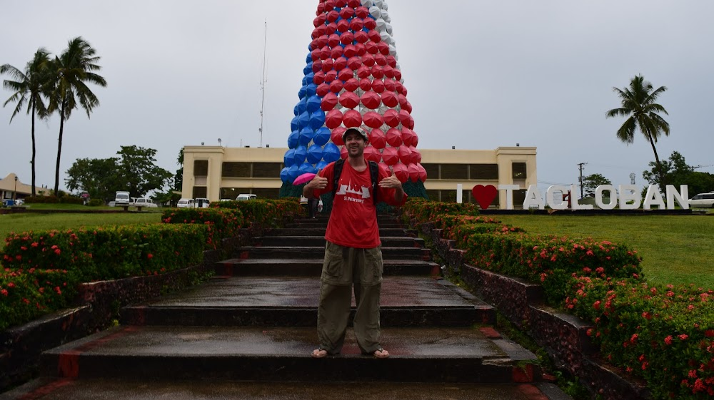 outside the city hall, which has a big artificial Christmas tree made of what looks like umbrellas, in the colours of the Philippine flag.