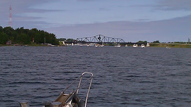 Photo: Boats waiting to go through a swing bridge at Little Current