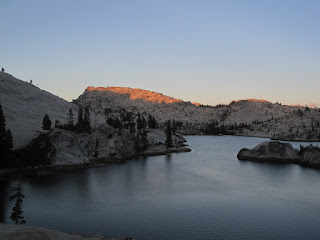 Rosy glow on the ridge northeast of the lake. ©http://backpackthesierra.com