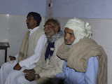 Villagers wait patiently to be seen by the doctor