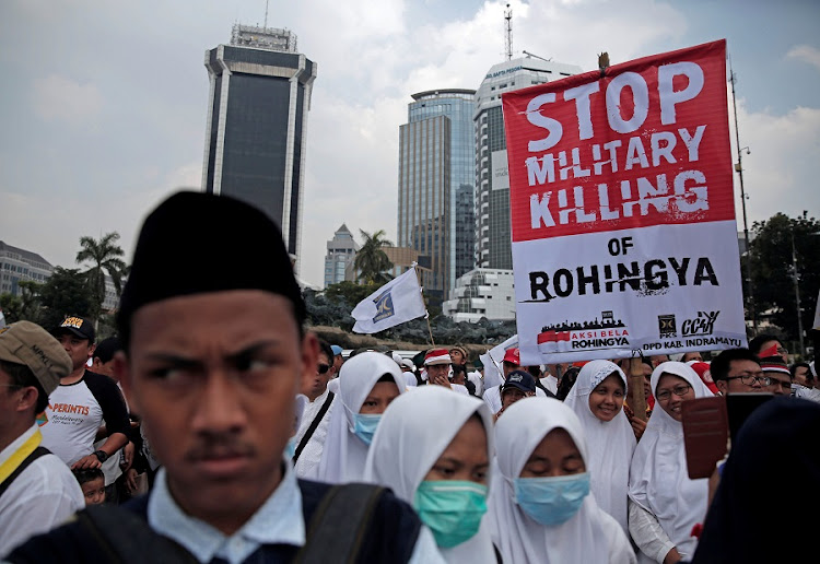 Muslim student holds poster during a protest against the treatment of the Rohingya Muslim minority by the Myanmar government, in Jakarta, Indonesia September 16, 2017. Picture: REUTERS/BEAWIHARTA