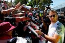 Jenson Button signs autographs for fans