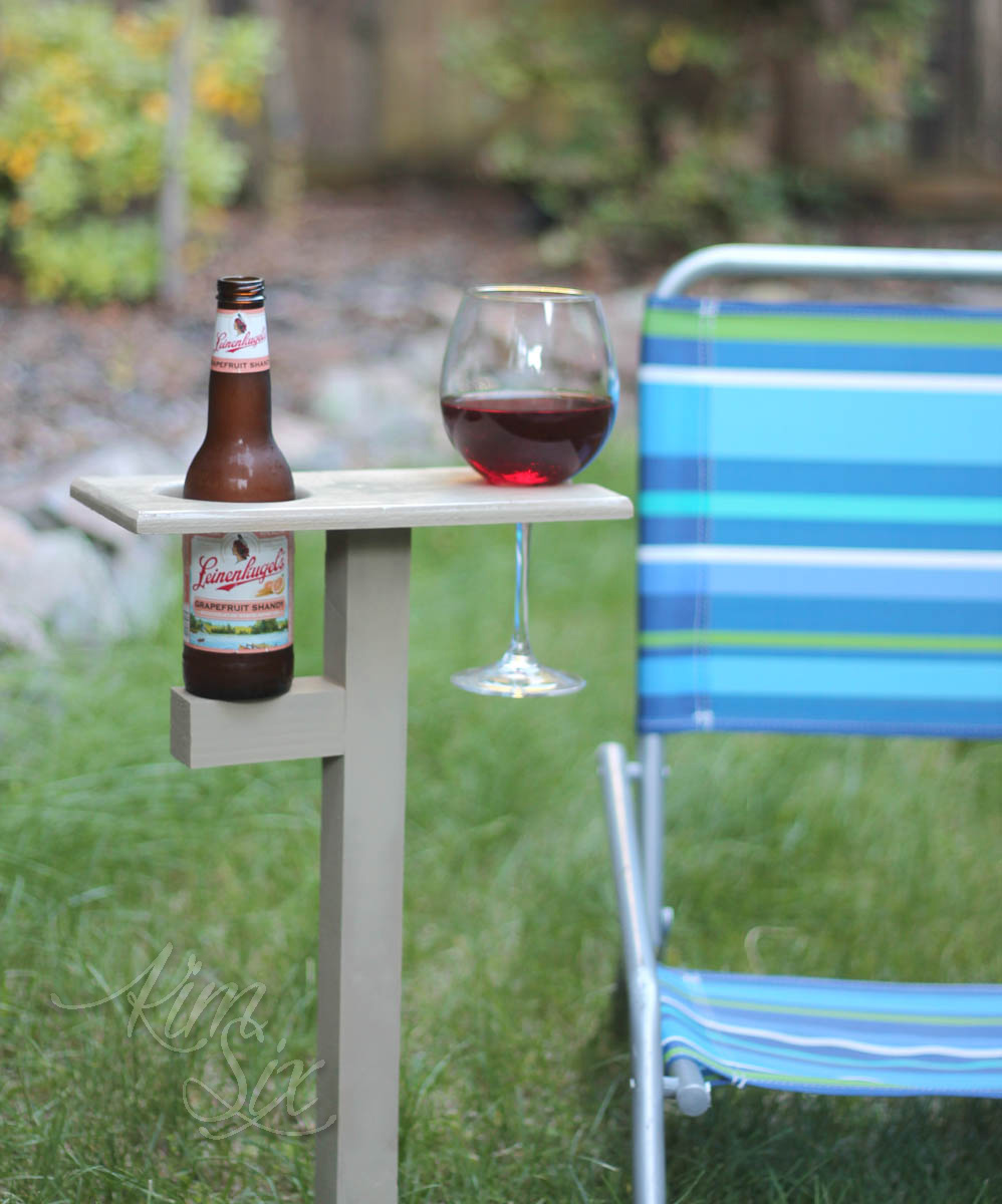 Wood beer and wine holder in lawn