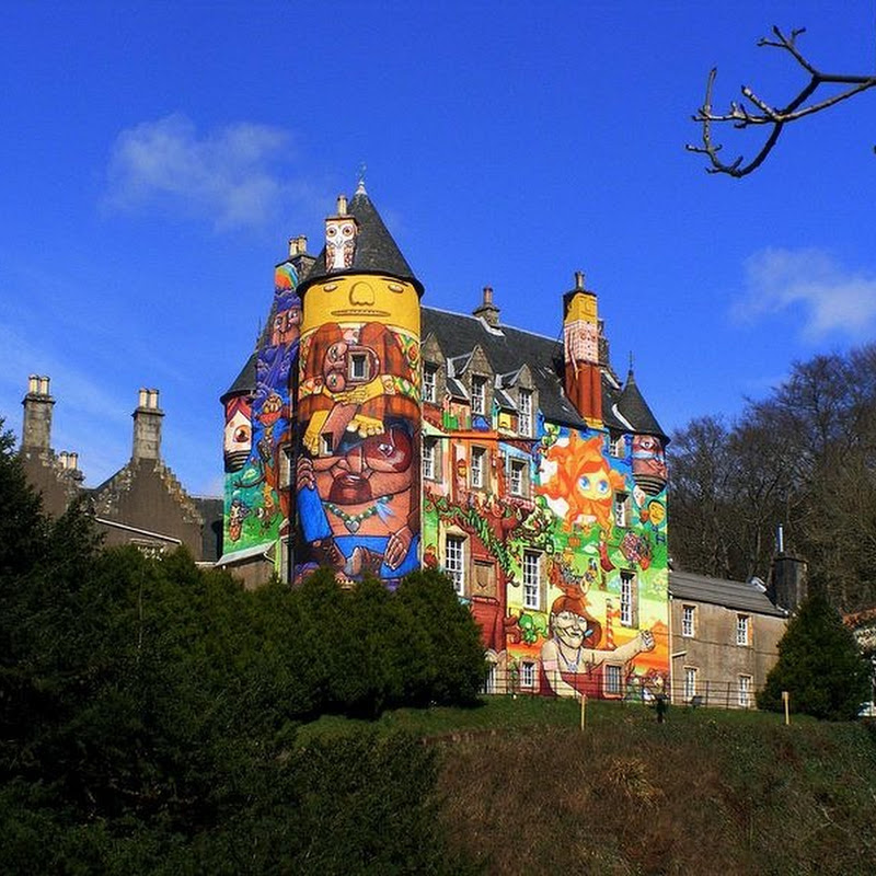 The 13th Century Kelburn Castle Covered With Colorful Graffiti