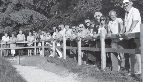 Eynsham Rotarians and friends admiring the new ramp they have funded at the Fishponds - image � Harold Jerred
