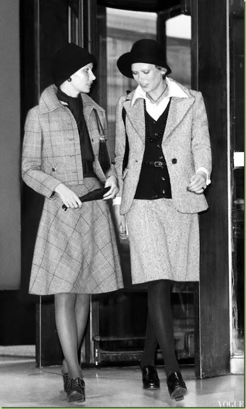 kourken-pakchanian-models-walking-together-out-of-a-revolving-door-at-left-wearing-a-glen-plaid-wool-suit-with-chopped-jacket-and-bias-skirt-by-house-of-branell- 1972