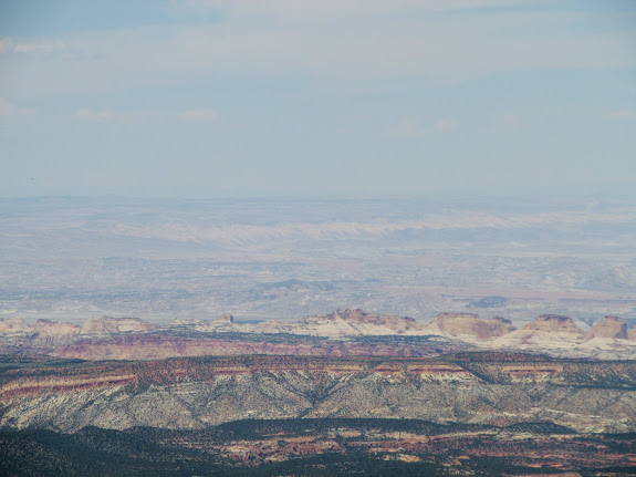 Capitol Reef in the foreground and the San Rafael Reef faintly visible in the distance