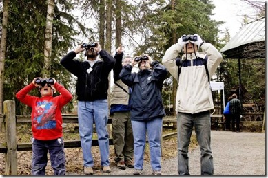 group-of-people-look-through-binoculars