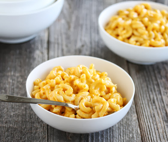 photo of a bowl of macaroni and cheese with a spoon