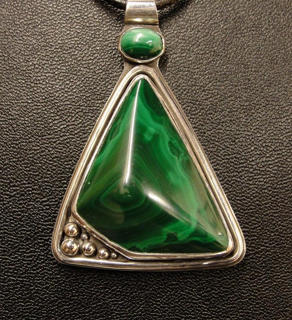 Unusual cut Malachite stone - $195