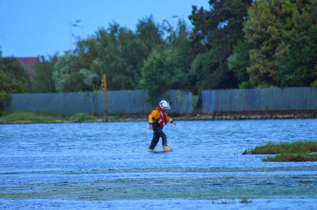 Poole ILB crew member walking across the mud in Holes Bay 6 June 2014 Photo: Scott Rowland, RNLI Poole