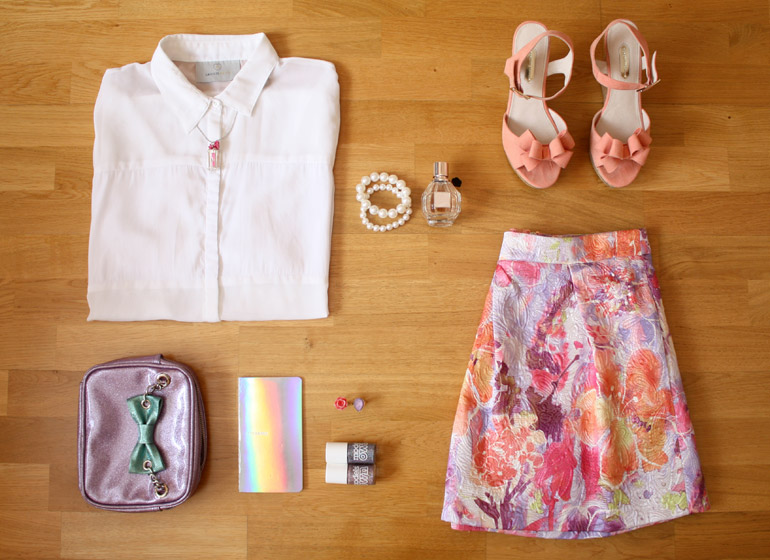 white blouse floral jacquard skirt fashion outfit flat lay from the high street