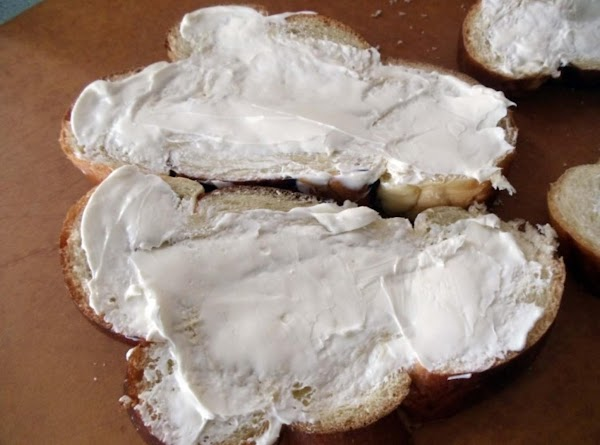 Spread cream cheese evenly over one side of each slice of bread.