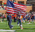 Nelson Logo #24 comes out with the American flag (NCAA Football: Illinois 17 vs. Indiana 31, October 27, 2012, Memorial Stadium, Champaign, IL)