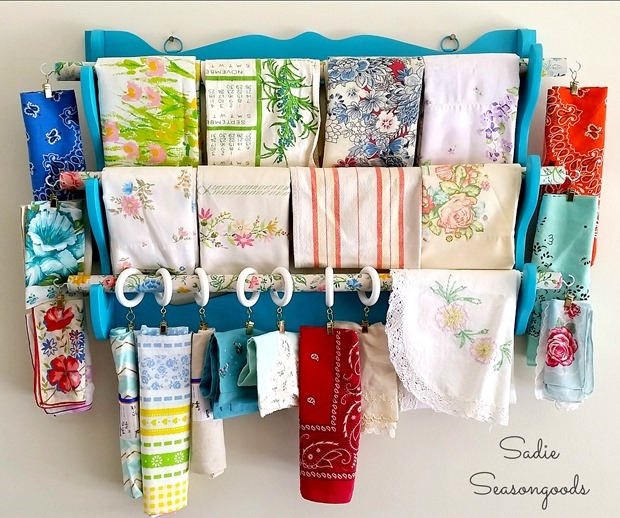11_thrifted_gun_rack_for_fabric_storage_with_mod_podge_dowels_using_a_vintage_sheet_by_Sadie_Seasongoods