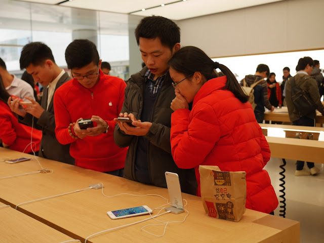 Apple employees with a customer