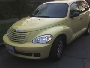 Here is a camera phone photo of my Dijon Yellow PT Cruiser. The educator from Aberdeen High School who I had been working with, loved the car when she saw it, so did my Aunt. I then gave up the idea of buying one. Photo taken on March 22, 2007.