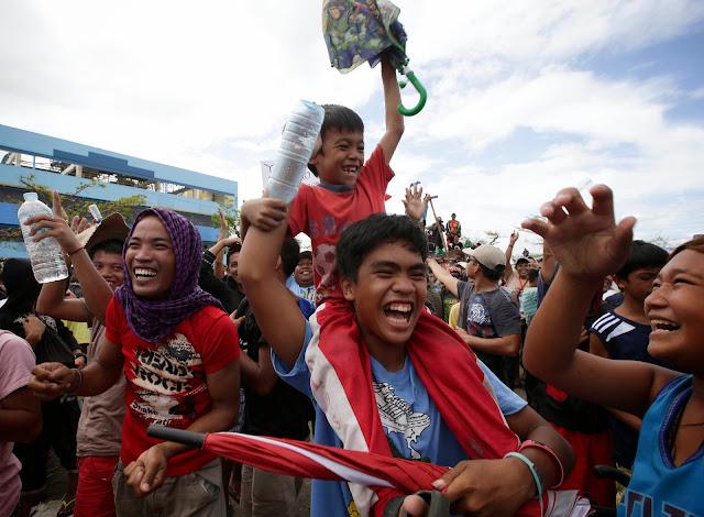Typhoon Yolanda survivors in Tacloban celebrate Manny Pacquiao's victory