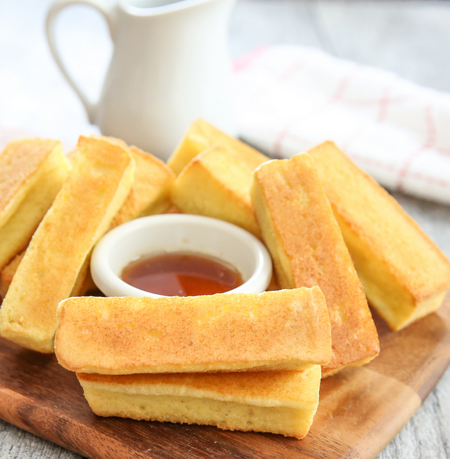 photo of french toast sticks with syrup in a small bowl
