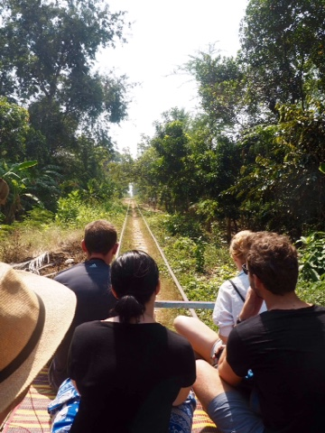 Riding the bamboo train through the countryside outside Battambang, Cambodia