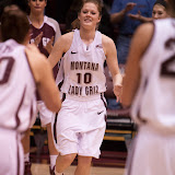 Senior guard Kenzie De Boer takes to the court as teammates Alyssa Smith, left, and Katie Baker wait to greet her.  Dahlberg Arena in Missoula, Mont., December 1st, 2012.