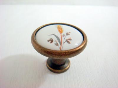 裝潢五金品名:S156-陶瓷取手規格:單孔(32m/m)顏色:AB+麥穗玖品五金