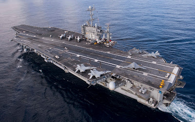 Obama is a no-show after Iran's near-miss of US aircraft carrier